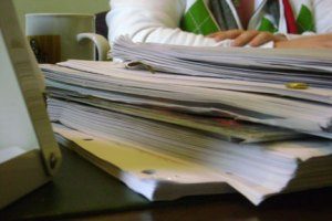Just one of the many stacks of scripts in Liz's office